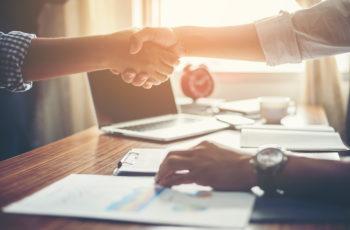 Business People Handshake Greeting Deal at work.